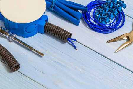 Spare parts and tool on blue boards for electrical prepared before repair or setting