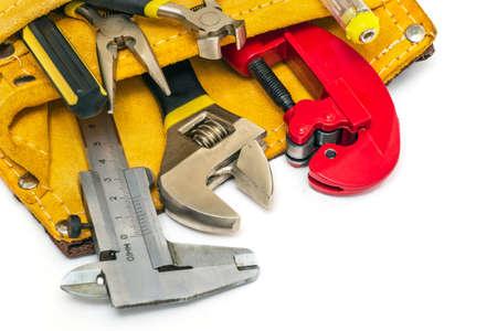 Builder tools set in suede bag on white background Zdjęcie Seryjne