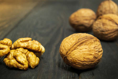 Walnuts on a vintage table. Peeled walnut kernel close up