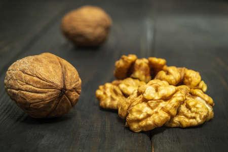 European walnut on a vintage table. Peeled walnut kernel close up