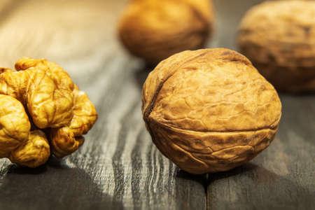 European walnuts on a vintage table. Peeled walnut kernel close up