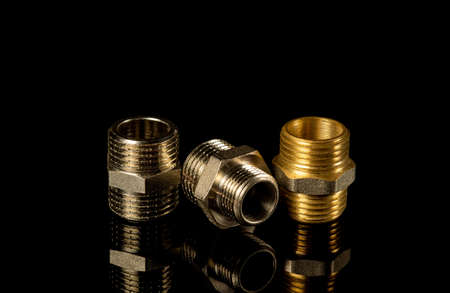 Set of brass fittings is often used to connect for gas and water installations. Fitting connecting pipes in plumbing Stock Photo