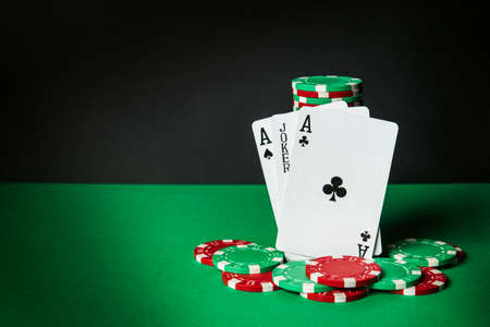 Poker cards with three of a kind or set combination. Close-up of playing cards and chips in poker club. Free advertising space Archivio Fotografico