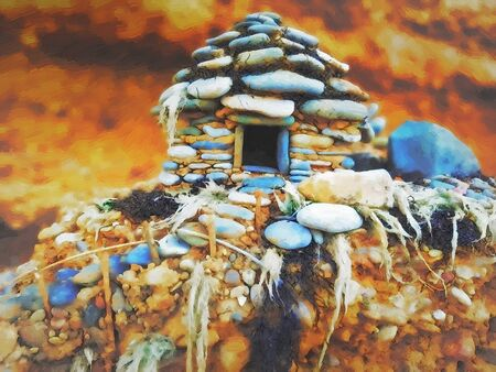 small pebble house by the sea. miniature