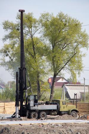 mechanic repair heavy machine in construction site Stock Photo