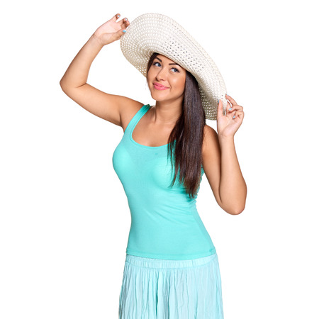 gratified: Smiling young sun-tanned woman in  tshirt and straw hat looking out of frame  isolated on white background Stock Photo