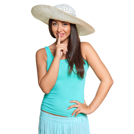 gratified: Smiling young sun-tanned woman in  tshirt and straw hat   isolated on white background