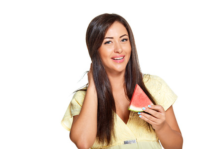 suntanned: young sun-tanned woman  dressed in yellow dress and holding slice of watermelon