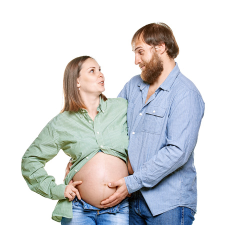 stout man with tummy and pregnant woman on a white background, isolated on a white background photo