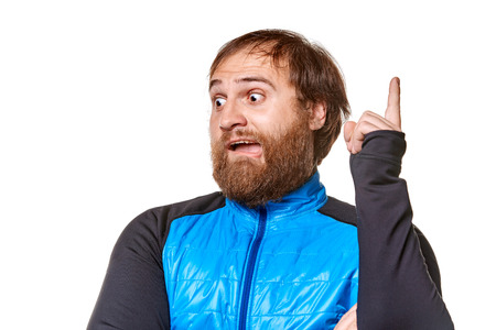 afflatus: stoutman  wearing jeans and blue sweater, shows forefinger, looking into the bottom corner, isolated on a white background Stock Photo