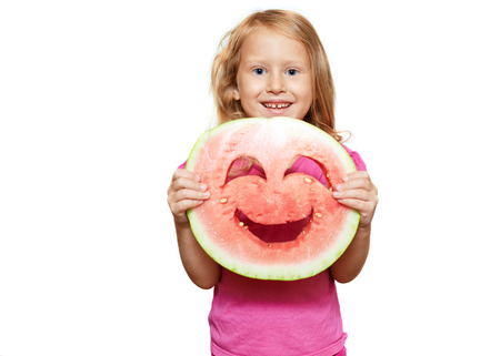 Girl with smiley of watermelon. Isolated on white photo