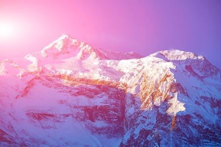 capped: Snow capped mountains. Himalaya, Nepal. Trek around Annapurna mount Stock Photo