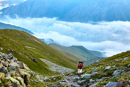 hikers on the trail in the Caucasian mountains. Trek to Kazbek mount Imagens - 42717555