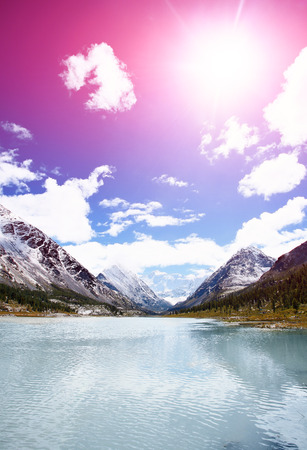 peaceful background: beautiful mountain lake at the foot of the mountain. Beluha mount region, Altay, Russia.