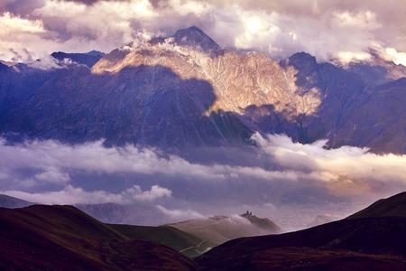 mestia: Caucasus green hills and mountains, on the sunset. Georgia Stock Photo