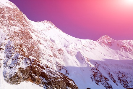 snow capped mountains: Snow capped mountains at the sunrise. Altay. Stock Photo