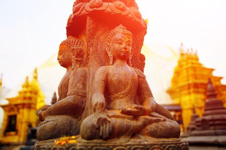 thai temple: Traditional Buddha statue in Swoyambhunath Temple,  Kathmandu, Nepal Stock Photo