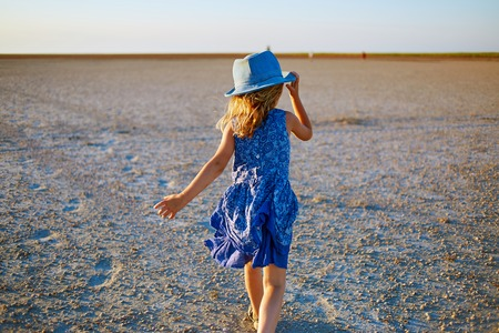 douther: girl in the desert at the  sunset Stock Photo