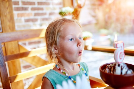 age 5: Portrait of little pretty girl with birthday ice cream, five years Stock Photo