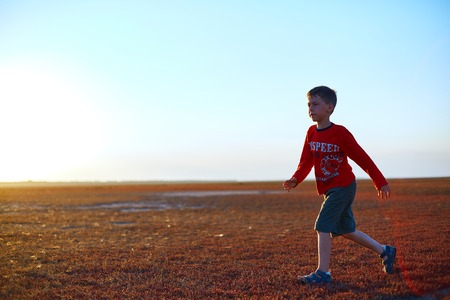 douther: boy in the desert at the  sunset