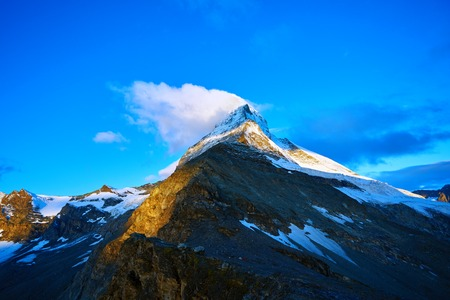 Snow capped mountains.   View of the  Matterhorn mount at the sunrise.