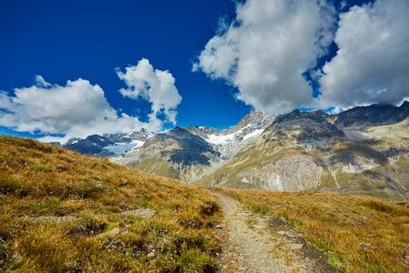 snow capped: Snow capped mountains.  Trek near Matterhorn mount.