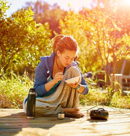 woman having breakfast  in the garden at morning
