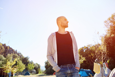 non urban 1: Handsome man relaxing in the climbing camping at early morning Stock Photo