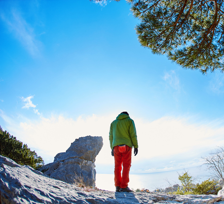rock climber: male rock climber on the rocks at winter sunny day Stock Photo