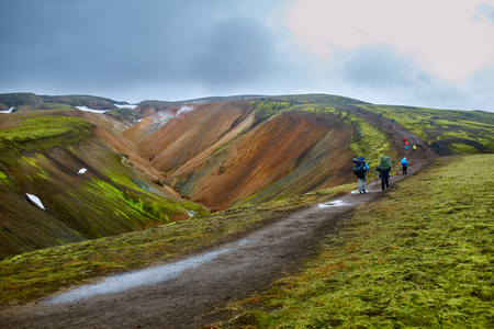snow fields: Valley National Park Landmannalaugar. On the gentle slopes of the mountains are snow fields and glaciers. Magnificent Iceland in the August