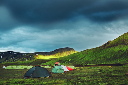 Travel to Iceland. Beautiful Icelandic landscape with mountains, sky and clouds. Trekking in national park Landmannalaugar. Rainy Evening in Camping near Alftavatn lake. Stock Photo