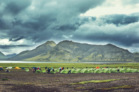 Travel to Iceland. Beautiful Icelandic landscape with mountains, sky and clouds. Trekking in national park Landmannalaugar. Rainy Evening in Camping near Alftavatn lake. Travel concept.