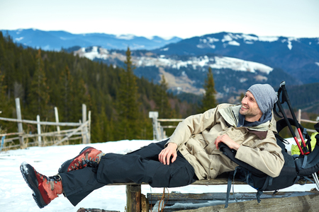 hiker have rest and drink tea on the trail in the Carpathians mountains at winter Stok Fotoğraf
