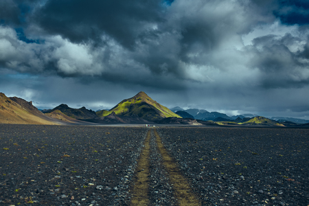 Travel to Iceland. Beautiful dramatic Icelandic landscape with mountains, sky and clouds. Trekking in national park Landmannalaugar. road in the Iceland. Stock Photo