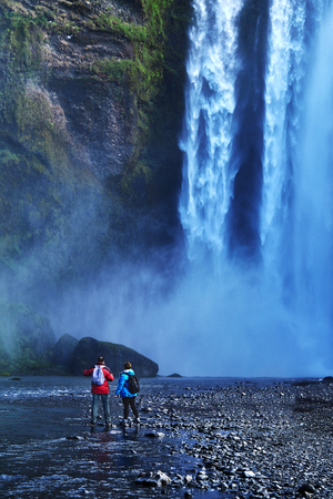 famous Skogarfoss waterfall in southern Iceland. treking in Iceland. Travel and landscape photography concept Stock Photo