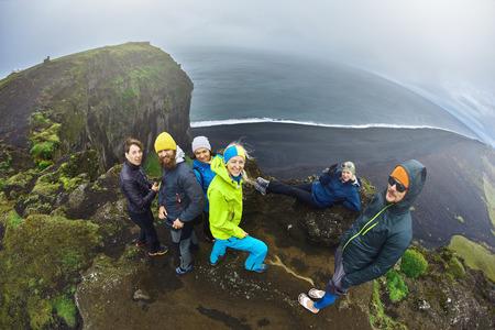 blue lagoon: Rreykjavik, Iceland - August 29, 2016: Tourists setting on Dyrholaey Cliff Iceland Stock Photo
