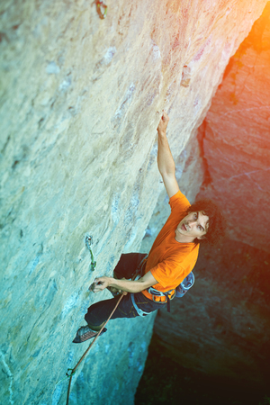 man rock climber. rock climber climbs on a rocky wall. outdoor climbing Reklamní fotografie