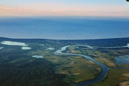 View from airplane window on the sea and coastline in Estonia, Tallinn.