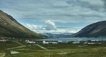 Travel to Iceland. A mountain road to the town of Isafjordur and a view of the fjord