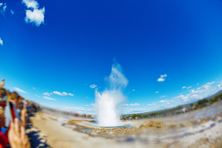breakout: Summer in Iceland. Eruption of Strokkur Geyser in Iceland. Magnificent geyser Strokkur. Fountain Geyser throws azure water every few minutes