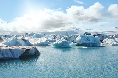 Beatufil vibrant picture of icelandic glacier and glacier lagoon with water and ice in cold blue tones, Iceland, Glacier Bay