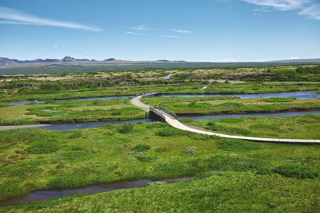 walkway in Thingvellir National Park, Iceland. Thingvellir National Park - famous area in Iceland right on the spot where the atlantic tectonic plates meets.