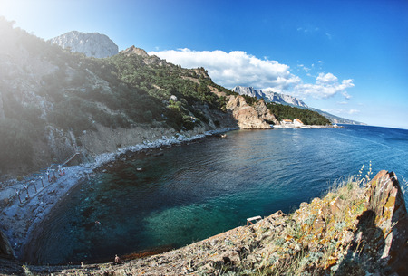 view on the cliffs and beach on the sea coast at summer in Crimea