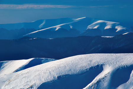 Landscape of beautiful snow mountain slope. Snowy winter mountains and blue sky. background for design Imagens