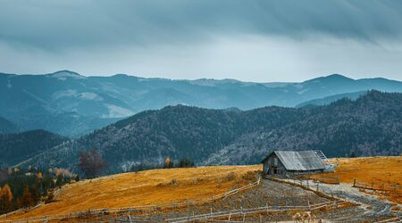 beautiful view of an autumn mountain landscape with a cloudy sky, Western Ukraine. Farm in the mountains Imagens
