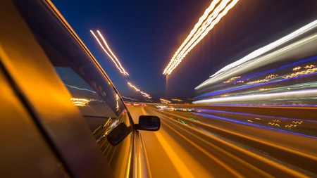 the traffic movement police: blurred urban look of the car movement nights long exposure Stock Photo