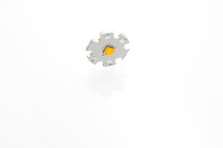 led lighting: High power warm white smd LED on aluminum star circuit isolated on white. Stock Photo