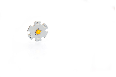 High power warm white smd LED on aluminum star circuit isolated on white. Stock Photo