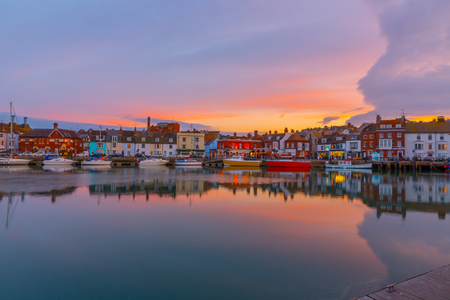 Fishing harbour at sunset in Weymouth, Dorset, UK