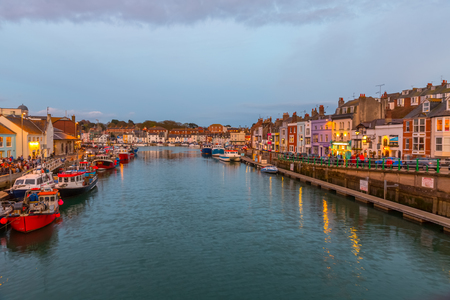Fishing harbour at sunset in Weymouth, Dorset, UK Stock Photo - 77712784